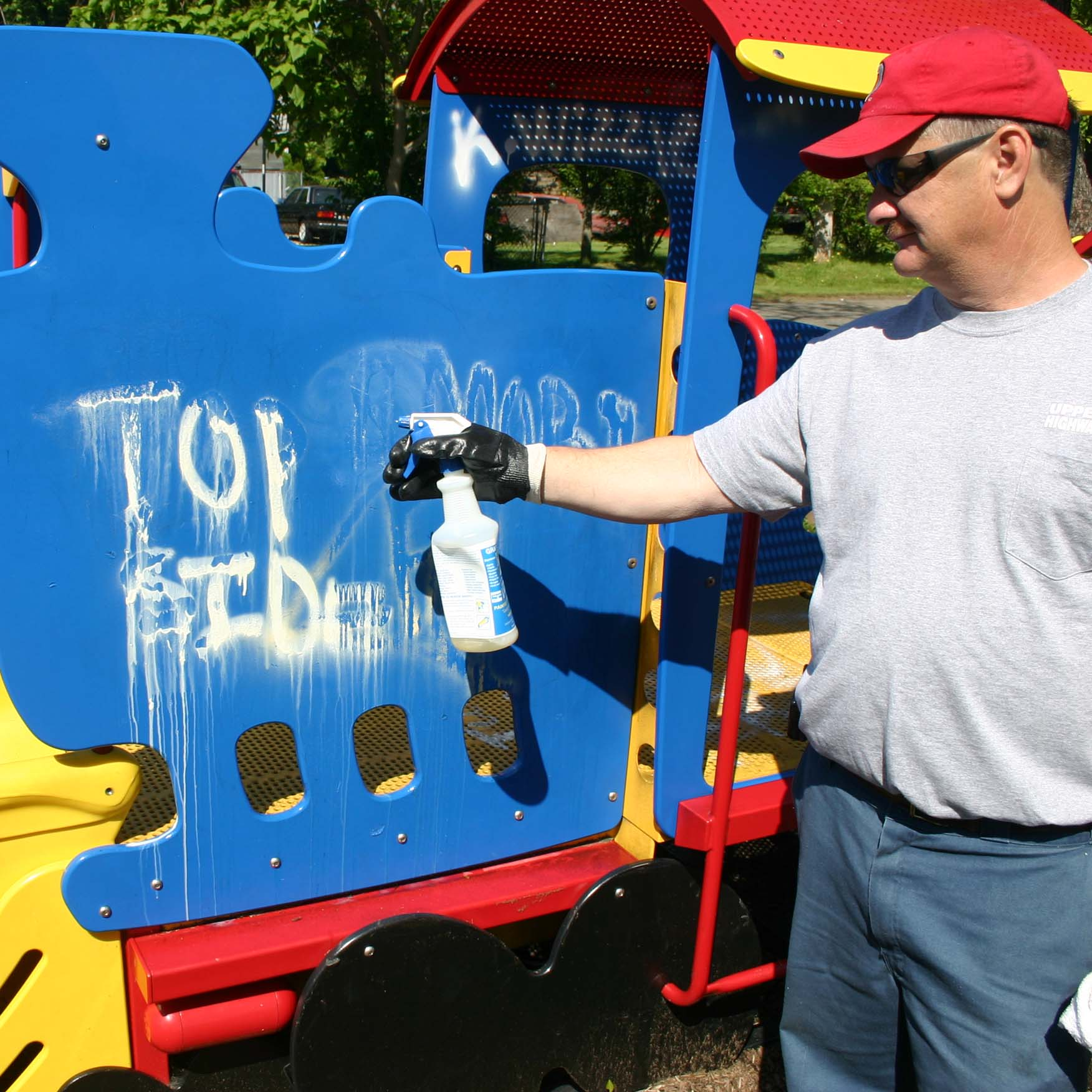 Graffiti Spray Remover Tagaway being applied to school playground