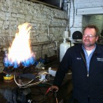 ETS Technician bench test firing a LP gas burner ring from a hot high pressure washer